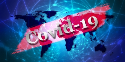 COVID-19, written over a world map graphic