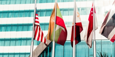 five flags in front of an office building