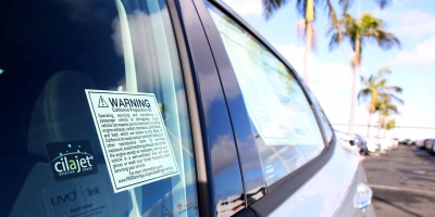 Proposition 65 warning sticker on the window of a new car