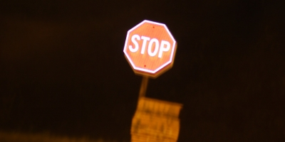glowing stop sign at night